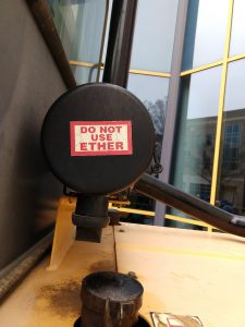 """Picture of a """"Do Not use Ether"""" sticker on a construction vehicle"""